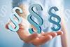Paragraphen-Zeichen als Symbol für rechtliche Aspekte berufsbedingter Allergien