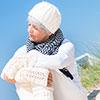 Ältere Dame genießt die Sonne am Strand - ©hailey_copter - stock.adobe.com