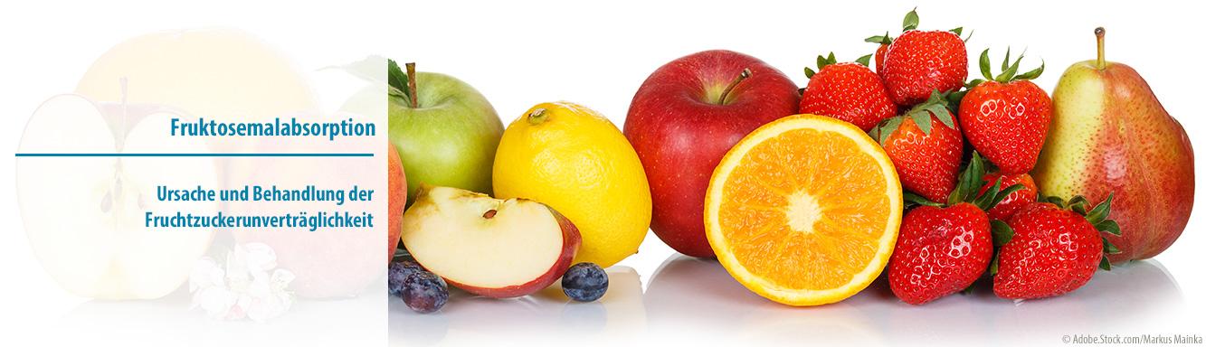 Buntes Obst und Beere mit Birne, Erdbeeren, Äpfel, Orange, Pfirisch, Blaubeeren und Zitrone